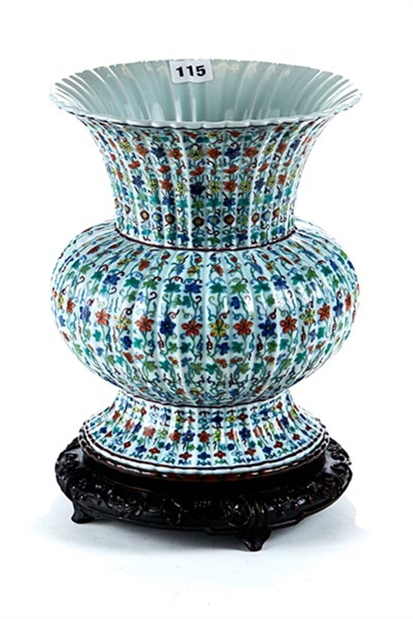 A Chinese ribbed porcelain Doucai style vase